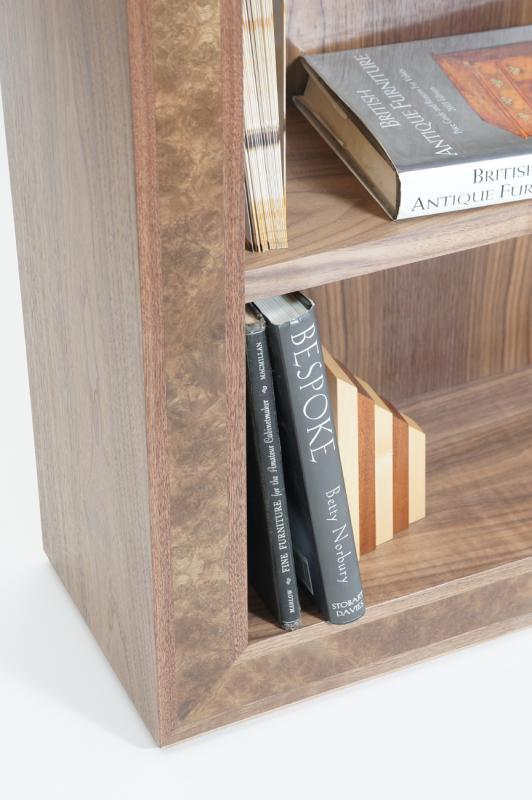 Bookcase in walnut corner detail by Dovetailors