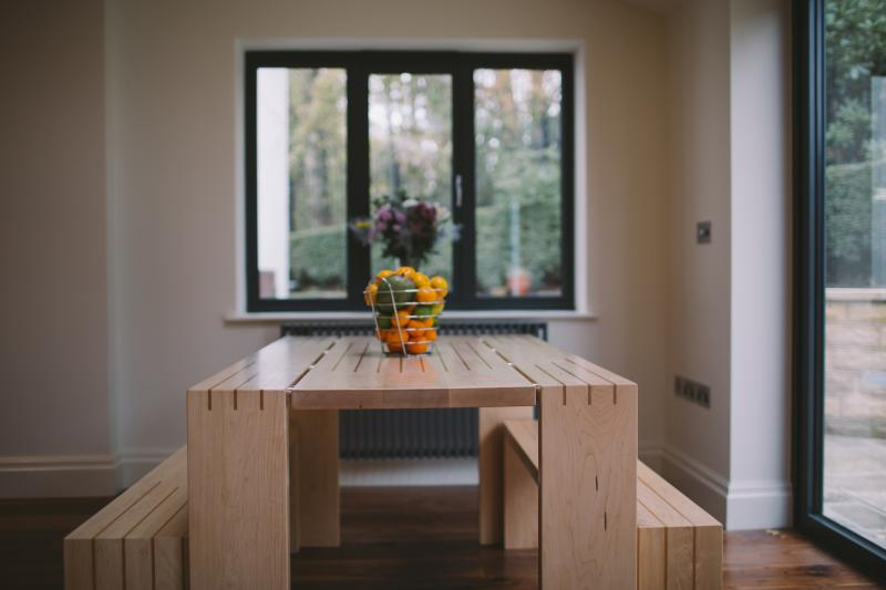 Dining table  and benches by Dovetailors